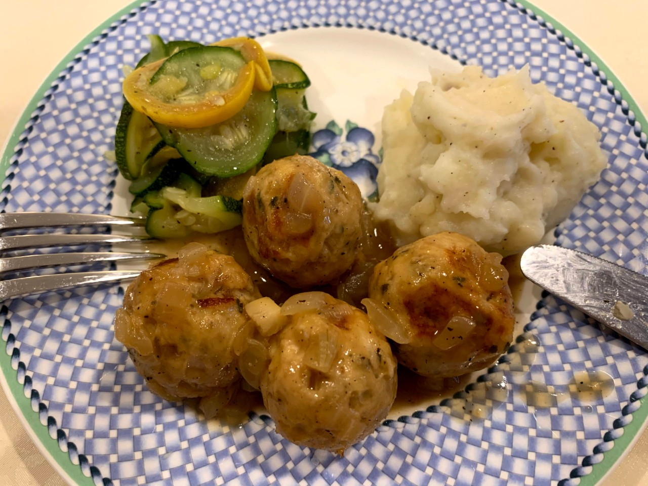 Plate with fork and knife, turkey meatballs, squash, and mashed potatoes
