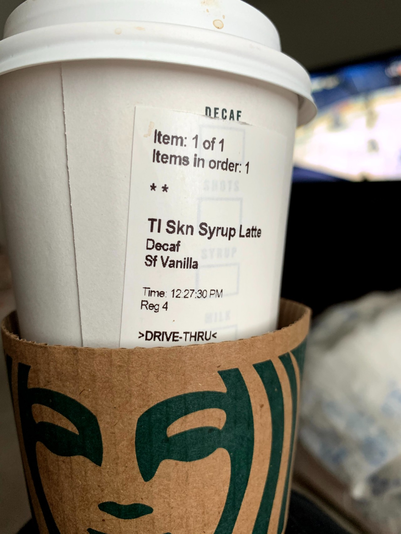 Starbucks cups with label showing and heat guard around the bottom