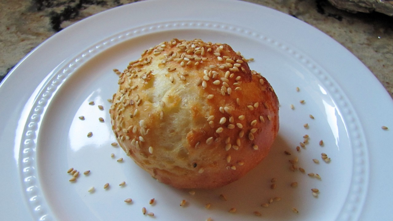 Bagel Bite with sesame seeds on top on a white plate